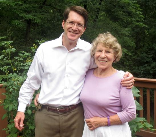 Justice Tomljanovich and Brian Hagerty pose for a photo on her back porch