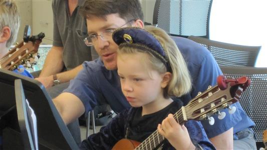 Maura and Brian at guitar camp (2012)