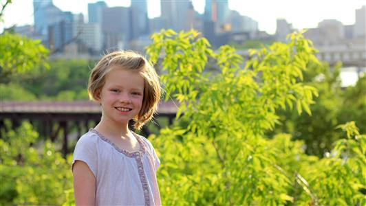Maura in front of the river and the Minneapolis skyline (2014)