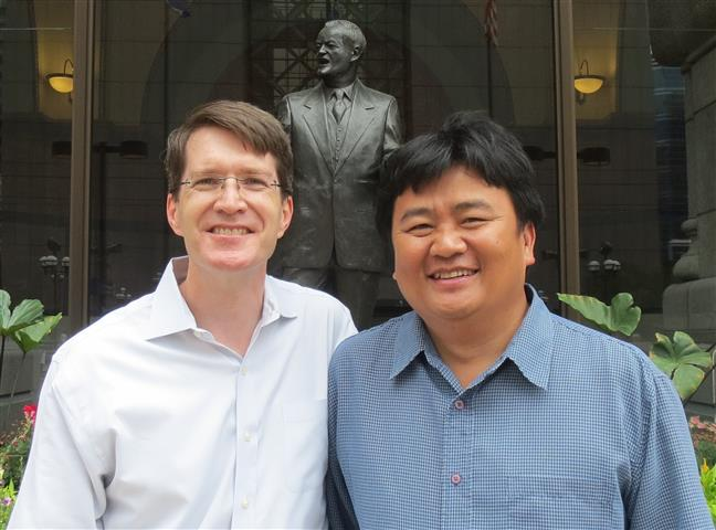 Blong Yang and Brian Hagerty outside City Hall