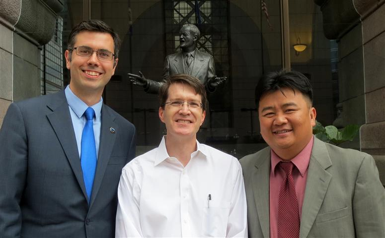 Brian, Andrew Johnson, and Blong Yang outside City Hall